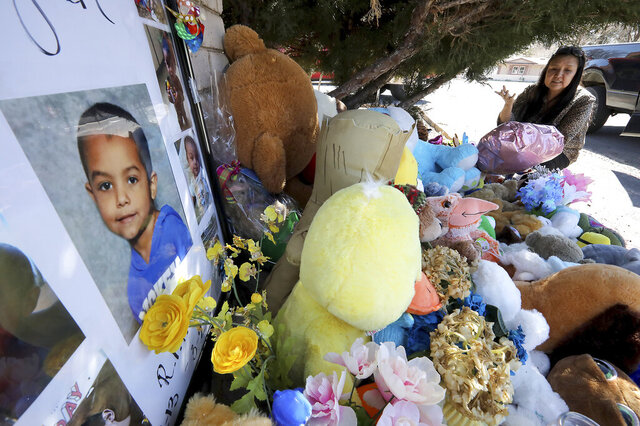 Wanda Ahasteen stops by a memorial for a 6-year-old boy in Flagstaff, Ariz., on Wednesday, March 4, 2020. Police have arrested the boy's parents and grandmother on suspicion of murder and child abuse in the boy's death. (Jake Bacon/Arizona Daily Sun via AP)
