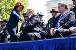 Attorney General William Barr looks on as President Donald Trump shakes hands with Speaker of the House Nancy Pelosi of Calif., during the 38th Annual National Peace Officers' Memorial Service at the U.S. Capitol, Wednesday, May 15, 2019, in Washington. (AP Photo/Evan Vucci)