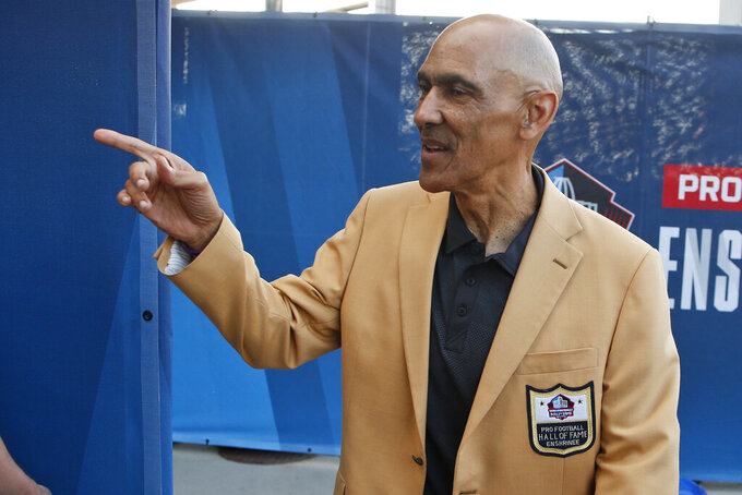 FILE - In this Aug. 3, 2019, file photo, former NFL player Tony Dungy is introduced before the induction ceremony at the Pro Football Hall of Fame in Canton, Ohio. Pro football is discovering that the spirit of the Rooney Rule is being violated.   NFL Commissioner Roger Goodell made that a point of emphasis in his state of the league speech during Super Bowl week. So count on Goodell finding ways to more strongly implement the policy that requires teams to interview minority candidates for coaching and executive positions.(AP Photo/Ron Schwane, File)