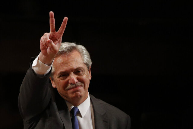 FILE - In this Nov. 5, 2019 file photo, Argentina's President-elect Alberto Fernandez gestures to supporters as he arrives to give a talk on the challenges facing Latin America, hosted by Mexico's National Autonomous University in Mexico City. Fernandez becomes president of Argentina on Tuesday Dic. 10, returning the country's Peronist political movement to power amid an economic crisis and rising poverty. (AP Photo/Rebecca Blackwell, File)