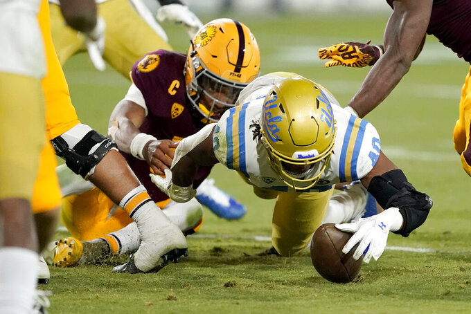 UCLA linebacker Caleb Johnson (40) recovers a fumble at the goal line against Arizona State during the second half of an NCAA college football game, Saturday, Dec. 5, 2020, in Tempe, Ariz. UCLA won 25-18. (AP Photo/Matt York)