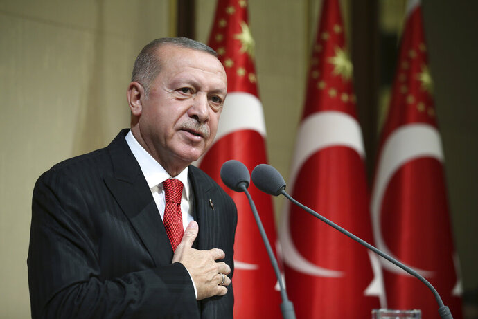 Turkish President Recep Tayyip Erdogan speaks during a reception on Republic Day, in Ankara, Turkey, Tuesday, Oct. 29, 2019. Erdogan said Russia has informed Turkey that Syrian Kurdish fighters have