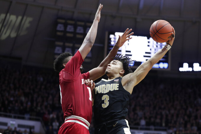 File-This Jan. 19, 2019, file photo shows Purdue guard Carsen Edwards (3) shooting over Indiana forward Juwan Morgan (13) during the second half of an NCAA college basketball game in West Lafayette, Ind. Edwards, a junior and preseason AP All-American listed at 6-0 on the NCAA leaderboard but 6-1 by the school, is seventh, national scoring at 24.6 points per game. (AP Photo/Michael Conroy, File)