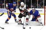 New York Islanders goaltender Semyon Varlamov (40) and teammate Adam Pelech (3) defend against Arizona Coyotes' Derek Stepan (21) during the first period of an NHL hockey game Thursday, Oct. 24, 2019, in Uniondale, N.Y. (AP Photo/Frank Franklin II)