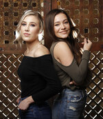 "In this March 20, 2019, photo, Madison Marlow, left, and Taylor Dye, of the duo Maddie & Tae, pose in Nashville, Tenn. Nearly four years after their first album, the country duo are releasing their first EP on their new label Mercury Nashville called ""One Heart to Another,"" on April 26. A full album will be released later this year. (AP Photo/Mark Humphrey)"