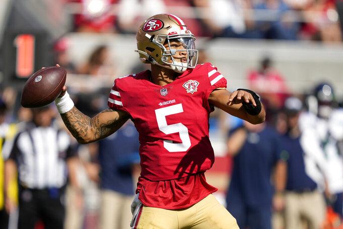 San Francisco 49ers quarterback Trey Lance (5) passes against the Seattle Seahawks during the second half of an NFL football game in Santa Clara, Calif., Sunday, Oct. 3, 2021. (AP Photo/Tony Avelar)