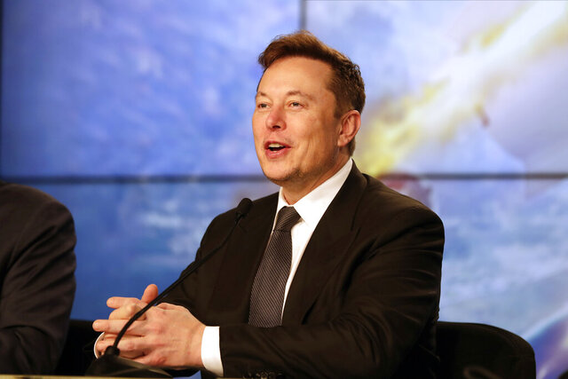 FILE - In this Jan. 19, 2020, file photo Elon Musk, founder, CEO, and chief engineer/designer of SpaceX speaks during a news conference at the Kennedy Space Center in Cape Canaveral, Fla. The meteoric rise of Tesla shares that pushed the company's value over $100 billion could turn into a supercharged payday for CEO Elon Musk. (AP Photo/John Raoux, File)