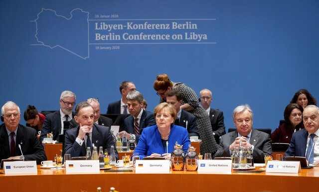 German Foreign Minister Heiko Maas, second left, German Chancellor Angela Merkel, center, and Antonio Guterres, second right, Secretary-General of the United Nations, attend a conference on Libya at the chancellery in Berlin, Germany, Sunday, Jan. 19, 2020. (Kay Nietfeld/DPA via AP, Pool)