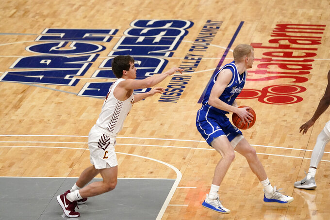 Drake's Garrett Sturtz, right, looks to pass as Loyola of Chicago's Braden Norris defends during the first half of the championship game in the NCAA Missouri Valley Conference men's basketball tournament Sunday, March 7, 2021, in St. Louis. (AP Photo/Jeff Roberson)