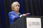New Mexico Gov. Michelle Lujan Grisham talks to experts in rural economic development in Santa Fe, N.M., on Tuesday, Nov. 5, 2019, at an event organized by the Western Governors' Association. Lujan Grisham, a Democrat, is withholding any endorsement in her party's presidential primary race. The former congresswoman says she is more interested in prescription drug reform to lower consumer costs that a comprehensive health care overhaul and believes in greater tax parity between the wealthy and middle class. (AP Photo/Morgan Lee)