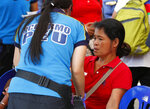 Medics attend to supporters of former Philippine First Lady Imelda Marcos outside a sports arena after falling ill during the 90th birthday celebration of the flamboyant wife of the late dictator Ferdinand Marcos Wednesday, July 3, 2019, in suburban Pasig city east of Manila, Philippines. Philippine officials say more than 240 people have been brought to hospitals due to suspected food poisoning in the event which was attended by more than a thousand