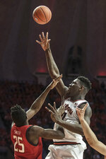 Illinois' Kofi Cockburn (21) shoots as Maryland's Jalen Smith (25) defends during the first half of an NCAA college basketball game Friday, Feb. 7, 2020, in Champaign, Ill. (AP Photo/Holly Hart)