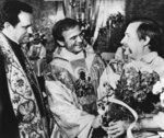 FILE - In this August 13, 1984 file photo Lech Walesa, former leader of Poland's Solidarity movement and Nobel Peace Prize laureate, right, speaks with priest Jerzy Popieliszko from Warsaw, and priest Henryk Jankowski, left, Walesa's personal spiritual consultant, after a holy mass at the St. Brigida church in Gdansk, Poland. Allegations against the late Mgr. Jankowski, one of the key figures in the Solidarity 1980 strikes, surfaced this week that he sexually abused minors. (AP Photo/Czarek Sokolowski)