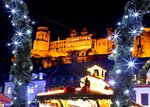 In this Tuesday, Dec. 4, 2018 photo lights shine in front of the castle at the traditional Christmas market in Heidelberg, Germany. The Christmas market In the Old Town of Heidelberg underneath the famous castle is one of most picturesque christmas markets in southern Germany.  (AP Photo/Michael Probst)