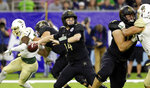 Vanderbilt quarterback Kyle Shurmur (14) passes the ball against Baylor during the first half of the Texas Bowl NCAA college football game Thursday, Dec. 27, 2018, in Houston. (AP Photo/Michael Wyke)