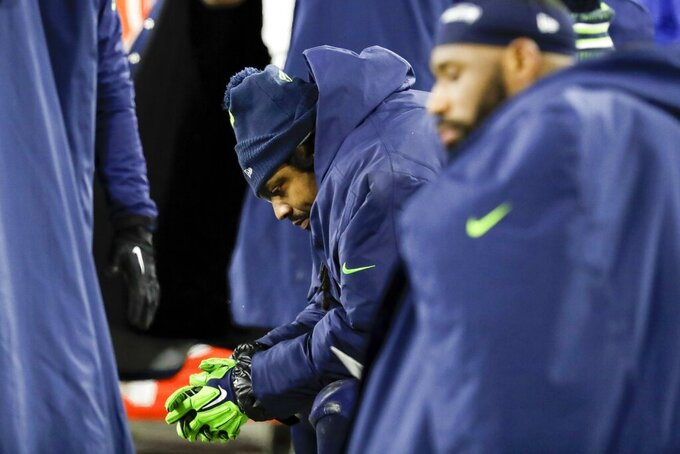 Seattle Seahawks' Marshawn Lynch sits on the bench during the second half an NFL divisional playoff football game against the Green Bay Packers Sunday, Jan. 12, 2020, in Green Bay, Wis. The Packers won 28-23 to advance to the NFC Championship. (AP Photo/Darron Cummings)