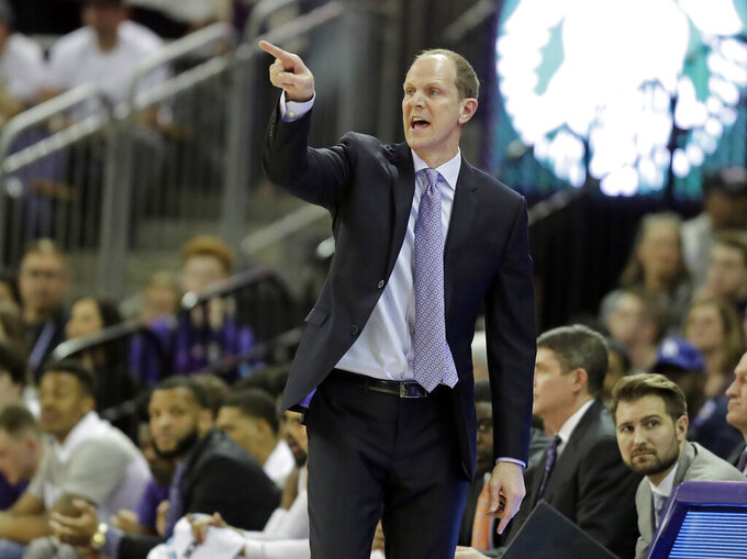 Washington head coach Mike Hopkins calls to his team during the first half of an NCAA college basketball game against Oregon, Saturday, March 9, 2019, in Seattle. (AP Photo/Ted S. Warren)