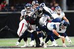 Tennessee Titans quarterback Logan Woodside (5) is sacked by Atlanta Falcons linebacker Erroll Thompson (53) during the first half of a preseason NFL football game, Friday, Aug. 13, 2021, in Atlanta. (AP Photo/John Bazemore)