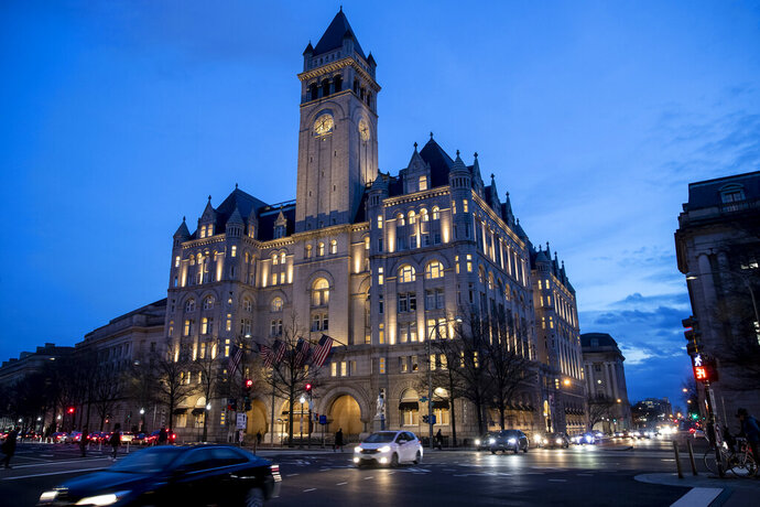 FILE - In this Jan. 23, 2019, file photo, the Trump International Hotel near sunset in Washington. An appeals court wants a judge to reconsider letting Justice Department lawyers immediately appeal a case accusing President Donald Trump of profiting off the presidency. The order issued Friday, July 19, by the U.S. Court of Appeals for the District of Columbia Circuit includes a reprimand of U.S. District Judge Emmet Sullivan for abusing his discretion. (AP Photo/Alex Brandon, file)