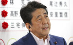 Japan's Prime Minister Shinzo Abe, leader of the Liberal Democratic Party, speaks during a TV interview about the ballot counting of the parliamentary upper house election, at their party headquarters in Tokyo, Sunday, July 21, 2019. Exit polls have showed Prime Minister Shinzo Abe's ruling coalition is certain to keep the majority of 124 seats contested in Sunday's upper house election, and could go even closer to the super-majority, the key line needed to propose a constitutional revision if joined by supporters from smaller parties. (AP Photo/Koji Sasahara)
