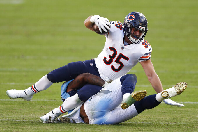 Chicago Bears running back Ryan Nall (35) is brought down by Tennessee Titans linebacker Derick Roberson (50) in the second half of an NFL football game Sunday, Nov. 8, 2020, in Nashville, Tenn. (AP Photo/Wade Payne)