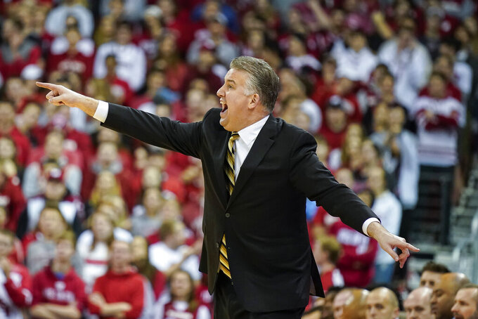 Purdue head coach Matt Painter yells to his team during the first half of an NCAA college basketball game against against Wisconsin Tuesday, Feb. 18, 2020, in Madison, Wis. Wisconsin won 69-65. (AP Photo/Andy Manis)