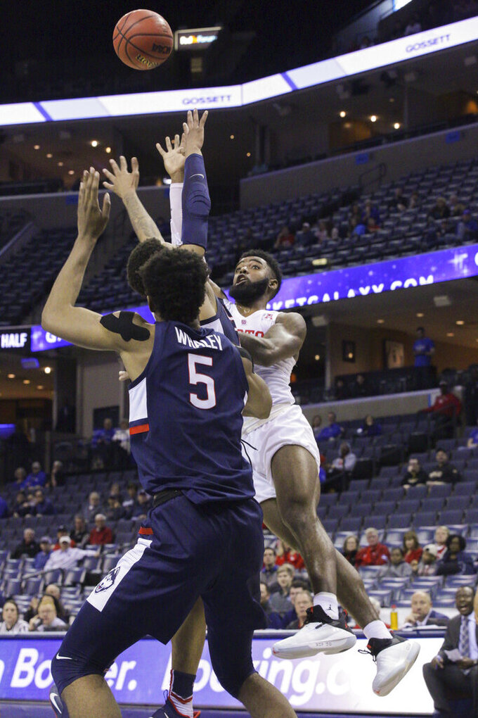 Houston's Corey Davis Jr. shoots the ball over Connecticut's player Isaiah Whaley (5) in the first half of an NCAA college basketball game at the American Athletic Conference tournament Friday, March 15, 2019, in Memphis, Tenn. (AP Photo/Troy Glasgow)