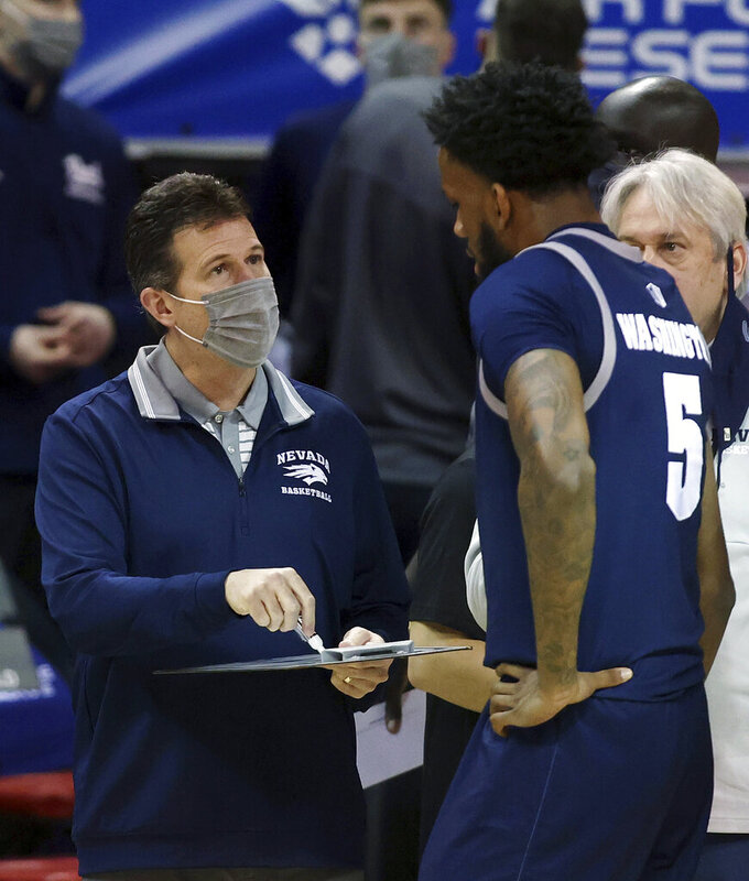 Nevada coach Steve Alford talks with forward Warren Washington (5) during the second half of the team's NCAA college basketball game against San Diego State in the semifinals of the Mountain West Conference men's tournament Friday, March 12, 2021, in Las Vegas. (AP Photo/Isaac Brekken)