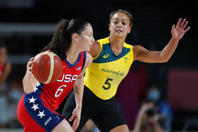 United States's Sue Bird (6) drives past Australia's Leilani Mitchell (5) during a women's basketball quarterfinal round game at the 2020 Summer Olympics, Wednesday, Aug. 4, 2021, in Saitama, Japan. (AP Photo/Charlie Neibergall)