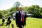 FILE - In this May 24, 2019 file photo, President Donald Trump speaks to members of the media on the South Lawn of the White House in Washington, before boarding Marine One for a short trip to Andrews Air Force Base, Md., and then on to Tokyo. Trump said the U.S. will bolster its military presence in the Middle East with an additional 1,500 troops. He said the troops will have a