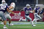 Stanford linebacker Duke Reeder (52) helps defend as Kansas State wide receiver Phillip Brooks (88) returns a punt in the first half of an NCAA college football game against Stanford in Arlington, Texas, Saturday, Sept. 4, 2021. (AP Photo/Tony Gutierrez)
