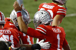 Ohio State quarterback Justin Fields, right, celebrates his touchdown against Rutgers with Wyatt Davis during the first half of an NCAA college football game Saturday, Nov. 7, 2020, in Columbus, Ohio. (AP Photo/Jay LaPrete)