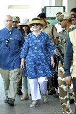 Former U.S. Secretary of State Hillary Clinton, center, comes out of the Jodhpur airport upoon her arrival in Jodhpur, Rajasthan state, India, Tuesday, March 13, 2018. (AP Photo/Sunil Verma)