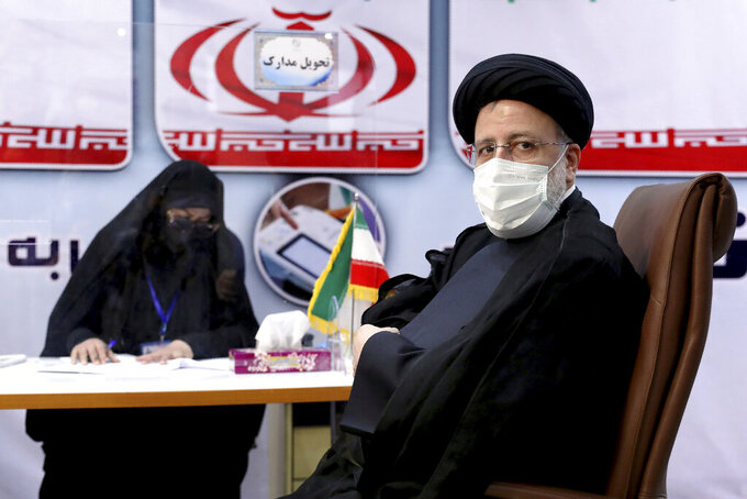 Ebrahim Raisi, head of Iran's judiciary registers his name as a candidate for the June 18 presidential elections at the interior Ministry in Tehran, Iran, Saturday, May 15, 2021. (AP Photo/Ebrahim Noroozi)