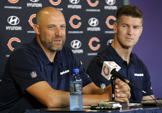 FILE - In this July 19, 2018, file photo, Chicago Bears head coach Matt Nagy, left, speaks as general manager Ryan Pace looks on at a news conference during an NFL football training camp in Bourbonnais, Ill. A worst-to-first jump last season left the Bears staring down at the rest of the NFC North, armed and loaded with one of the league's best defenses and banking on a more creative offense led by quarterback Mitchell Trubisky to improve Nagy's second season. As good as it all sounds, Pace was not resting easy the past few months.(AP Photo/Nam Y. Huh, File)