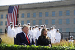 President Donald Trump and first lady Melania Trump participate in a program honoring the victims of the Sept. 11 terrorist attacks, Wednesday, Sept. 11, 2019, at the Pentagon. (AP Photo/Evan Vucci)