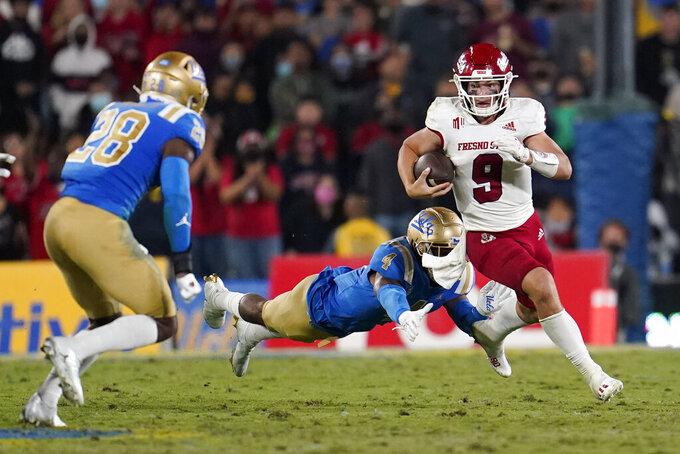 Fresno State quarterback Jake Haener (9) runs past UCLA defensive back Stephan Blaylock (4) during the second half of an NCAA college football game Sunday, Sept. 19, 2021, in Pasadena, Calif. (AP Photo/Marcio Jose Sanchez)