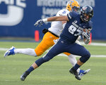 Utah State tight end Dax Raymond (87) catches a pass as San Jose State linebacker Jesse Osuna defends during an NCAA football game Saturday, Nov. 10, 2018, in Logan, Utah. (Eli Lucero/The Herald Journal via AP)