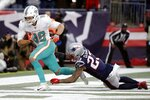 Miami Dolphins tight end Mike Gesicki, left, catches the winning touchdown pass in front of New England Patriots safety Patrick Chung in the second half of an NFL football game, Sunday, Dec. 29, 2019, in Foxborough, Mass. (AP Photo/Elise Amendola)
