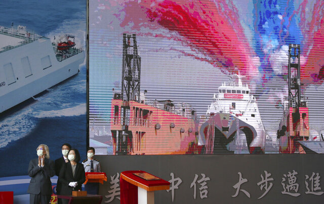Taiwan's President Tsai Ing-wen speaks during a delivery and launching ceremony of domestically built warships at the Jong Shyn Shipbuilding Corp's shipyards in Kaohsiung, southern of Taiwan, Friday, Dec. 11, 2020. (AP Photo/Chiang Ying-ying)