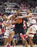 Washington forward Nate Roberts, center, battles for a rebound against Stanford forward Spencer Jones (14) and forward Oscar da Silva (13) during the first half of an NCAA college basketball game Thursday, Jan. 9, 2020, in Stanford, Calif. (AP Photo/Tony Avelar)