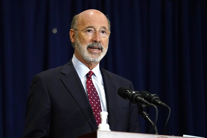 FILE - In this Nov. 4, 2020, file photo, Pennsylvania Gov. Tom Wolf speaks during a news conference in Harrisburg, Pa., regarding the counting of ballots in the 2020 general election. Facing a deep, pandemic-inflicted budget deficit, Gov. Wolf will ask lawmakers for billions of dollars funded by higher taxes on Pennsylvania's huge natural gas industry for workforce development and employment assistance to help the state recover. (AP Photo/Julio Cortez, File)