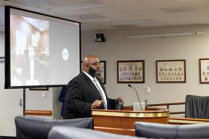 FILE - South Carolina Department of Juvenile Justice Director Freddie Pough testifies in front of state lawmakers in Columbia, S.C., on Thursday, May 20, 2021. The leader of South Carolina's juvenile justice agency announced Tuesday, Sept. 21, 2021 he is quitting about three months after officers and teachers walked off the job leading to a no confidence vote from state senators. (AP Photo/Michelle Liu, file)