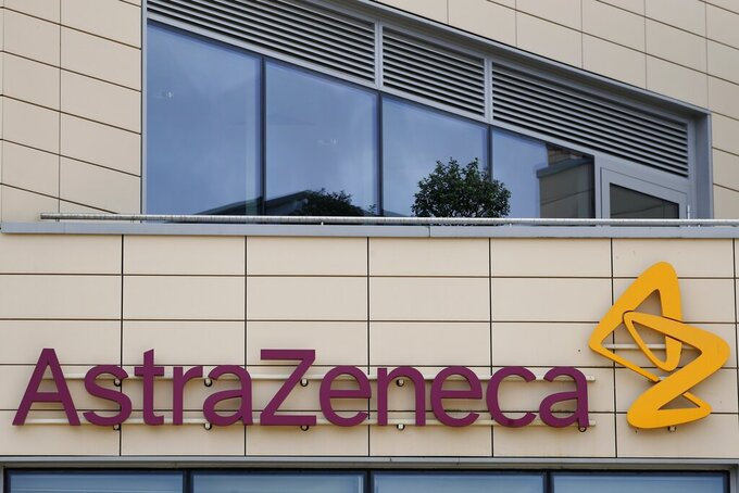FILE - In this Saturday, July 18, 2020 file photo a general view of AstraZeneca offices and the corporate logo in Cambridge, England. The European Commission will try this week to persuade a Belgian court to order the AstraZeneca pharmaceutical company to deliver millions of doses of its COVID-19 vaccines to EU countries. The EU accuses the Anglo-Swedish drugmaker of failing to deliver the number of shots it agreed. AstraZeneca's contract signed with the Commission on behalf of all 27 EU member states foresaw an initial 300 million doses for distribution among member countries, with an option for a further 100 million. The doses were expected to be delivered throughout 2021 but only 30 million were sent during the first quarter. (AP Photo/Alastair Grant, File)