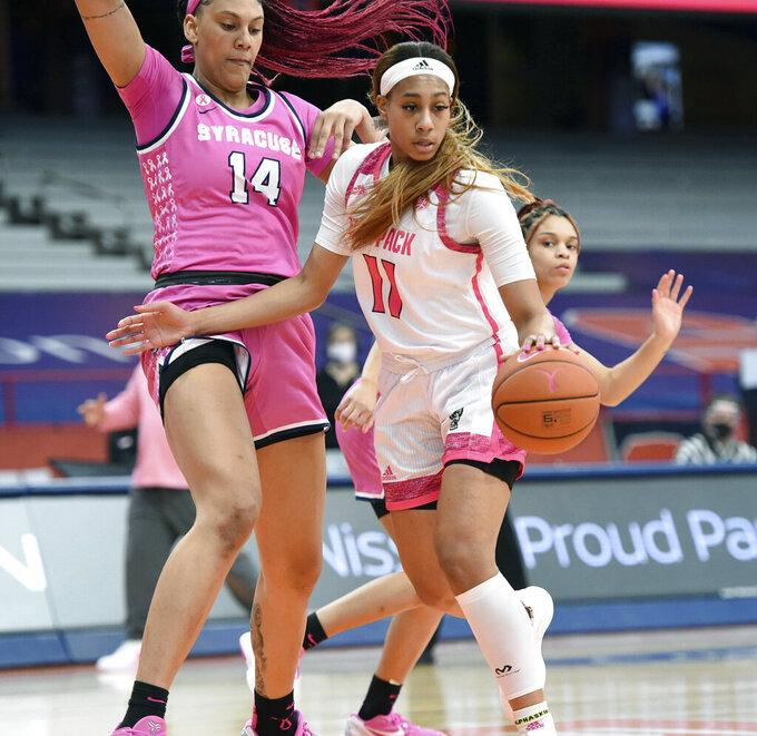 North Carolina State forward Jakia Brown-Turner (11) blocks Syracuse center Kamilla Cardoso (14) during an NCAA college basketball game in Syracuse, N.Y., Sunday, Feb 28, 2021. (Dennis Nett/The Post-Standard via AP)