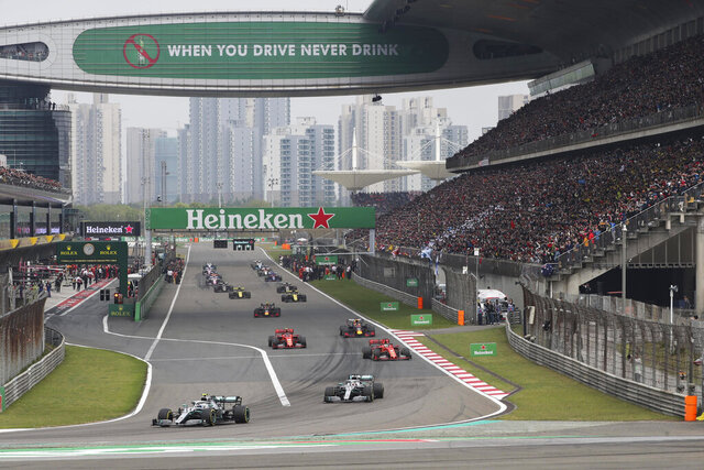 FILE - In this Sunday, April 14, 2019, file photo, drivers prepare for the start of the Chinese Formula One Grand Prix at the Shanghai International Circuit in Shanghai, China. Formula One's governing body on Wednesday, Feb. 12, 2020, says Shanghai Grand Prix scheduled for April postponed due to virus. (AP Photo/Ng Han Guan, File)