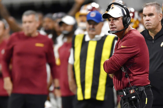 Washington Redskins head coach Jay Gruden watches play against the Atlanta Falcons during the first half an NFL preseason football game, Thursday, Aug. 22, 2019, in Atlanta. (AP Photo/Mike Stewart)