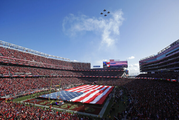 U.S. Navy F-35 jets fly over Levi's Stadium during the national anthem before an NFL divisional playoff football game between the San Francisco 49ers and the Minnesota Vikings, Saturday, Jan. 11, 2020, in Santa Clara, Calif. (AP Photo/Jeff Chiu)