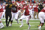 Arkansas running back Rakeem Boyd, center, runs the ball against Missouri during the first half of an NCAA college football game, Friday, Nov. 29, 2019, in Little Rock, Ark. (AP Photo/Michael Woods)