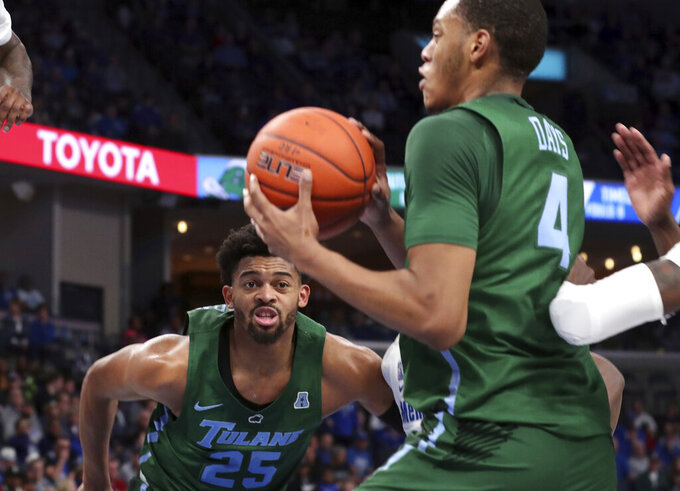 Tulane guard Christion Thompson (25) watches the ball as teammate forward Nobal Days(4) looks to pass in the first half of an NCAA college basketball game against Memphis, Monday, Dec. 30, 2019, in Memphis, Tenn. (AP Photo/Karen Pulfer Focht)
